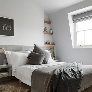Photo of a medium sized scandinavian gender neutral teen's room in London with white walls, light hardwood flooring and beige floors.
