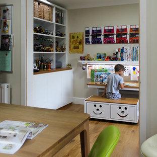 Photo of a contemporary kids' room in Cambridgeshire with medium hardwood flooring.