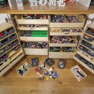 Playroom - contemporary medium tone wood floor playroom idea in London