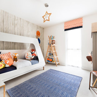 Inspiration for a medium sized scandinavian gender neutral children's room in Hampshire with white walls and carpet.