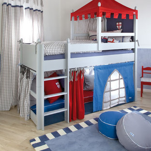 Inspiration for a traditional kids' room for boys and kids 4-10 years old in London with grey walls and light hardwood floors.