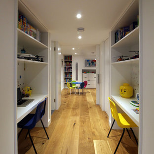 Inspiration for a large contemporary gender neutral children's room in Other with white walls and light hardwood flooring.