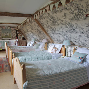 Photo of a large country gender neutral kids' room in Wiltshire with carpet and multi-coloured walls.