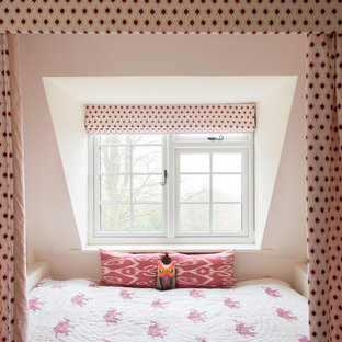 This is an example of a classic children's room for girls in Gloucestershire with white walls.
