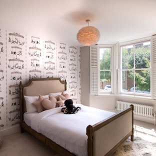 Photo of a medium sized classic children's room for girls in London with grey walls, carpet and beige floors.