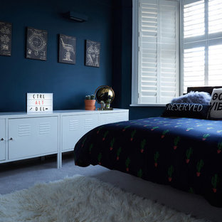 Inspiration for a medium sized contemporary teen's room for boys in London with blue walls and carpet.