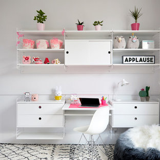Design ideas for a small modern kids' room for girls in London with grey walls, carpet and beige floor.