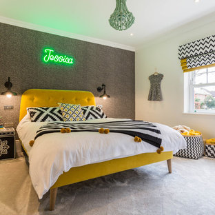 This is an example of a medium sized eclectic teen's room for girls in Kent with white walls, carpet and grey floors.