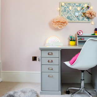 Design ideas for a traditional kids' study space for girls in Other with pink walls, carpet and beige floors.