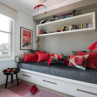 Design ideas for a contemporary kids' bedroom for girls in London with grey walls.