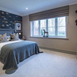 Design ideas for a medium sized classic kids' bedroom for boys in Surrey with beige walls, carpet and grey floors.