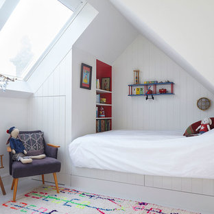 Design ideas for a medium sized contemporary children's room for boys in London with white walls, light hardwood flooring and beige floors.