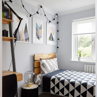 This is an example of a classic teen's room for boys in London with grey walls, carpet and grey floors.