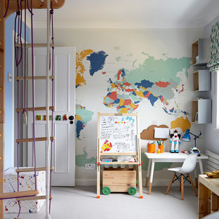Photo of a classic gender neutral kids' bedroom in London with blue walls, carpet and grey floors.