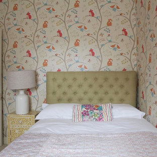 This is an example of a classic children's room for girls in London with multi-coloured walls.