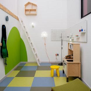 Inspiration för ett funkis könsneutralt barnrum kombinerat med lekrum, med vita väggar och flerfärgat golv