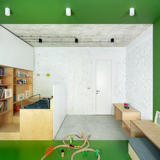 Mittelgroßes Industrial Kinderzimmer mit Schlafplatz, grüner Wandfarbe und grünem Boden in London
