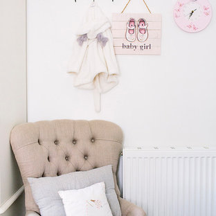 Example of a cottage chic kids' room design in London
