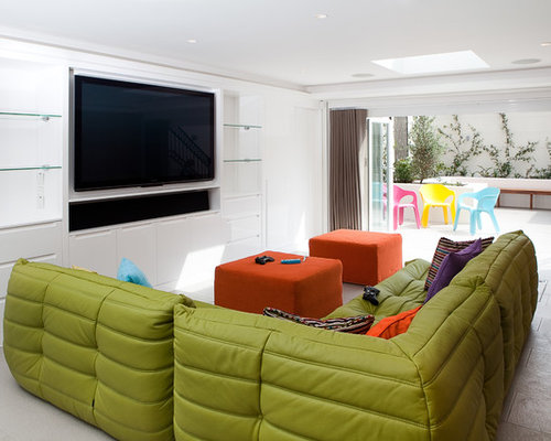 Contemporary gender neutral playroom idea in London with white walls. Tv Room Sofa   Houzz