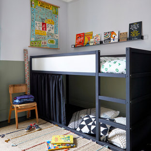 Inspiration for a scandinavian children's room for boys in London with multi-coloured walls.
