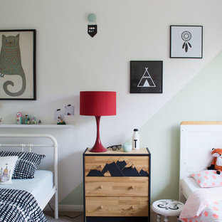 Inspiration for a small scandinavian gender neutral children's room in Kent with white walls and carpet.