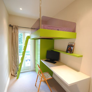 This is an example of a small contemporary gender neutral teen's room in London with white walls.