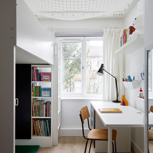 Design ideas for a small scandi kids' bedroom in London with multi-coloured walls and light hardwood flooring.