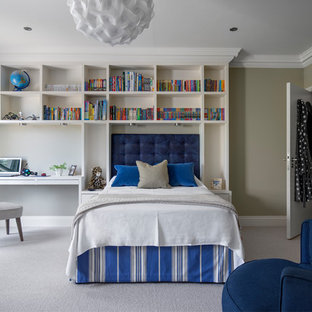 This is an example of a medium sized classic children's room for boys in Surrey with beige walls, carpet and grey floors.