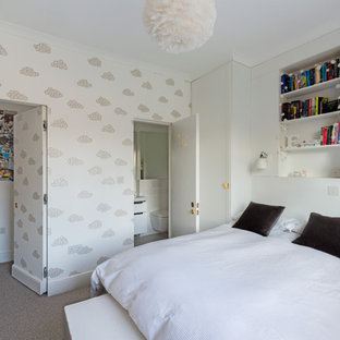 Inspiration for a contemporary gender neutral teen's room in London with white walls and carpet.