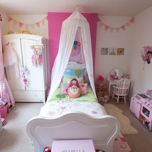Kids' room - small eclectic carpeted kids' room idea in Berkshire with white walls