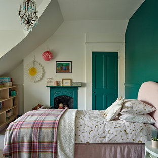 Photo of a mid-sized victorian kids' room for girls in London with green walls, carpet and grey floor.