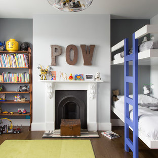 Medium sized contemporary children's room for boys in London with grey walls, dark hardwood flooring and brown floors.