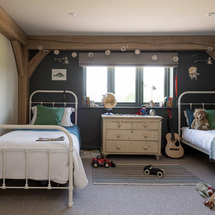 Photo of a farmhouse children's room for boys in West Midlands with blue walls, carpet and grey floors.