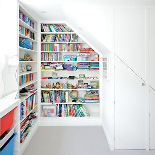 Kids' room - contemporary gender-neutral kids' room idea in London with white walls