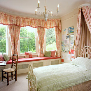Example of an ornate girl carpeted kids' bedroom design in London with beige walls
