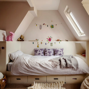 Design ideas for a small contemporary children's room for girls in Hampshire with carpet.