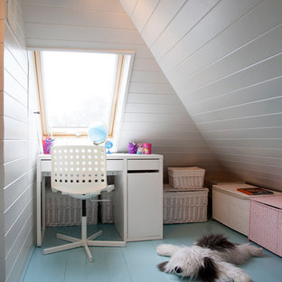 Contemporary kids' bedroom for girls in London with white walls, painted wood flooring and blue floors.