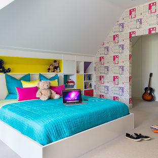 Inspiration for a medium sized contemporary children's room for girls in Other with multi-coloured walls, carpet and beige floors.