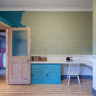 Medium sized traditional teen's room in Manchester with light hardwood flooring and multi-coloured walls.