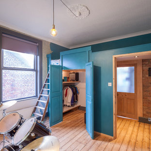 Design ideas for a medium sized traditional teen's room in Manchester with blue walls and light hardwood flooring.