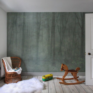 Design ideas for a medium sized contemporary children's room for boys in London with white walls, painted wood flooring and white floors.