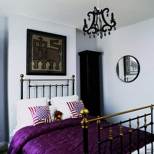 Bohemian kids' room in London with white walls.
