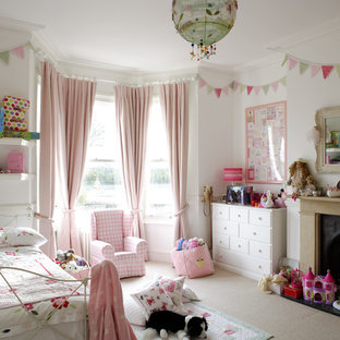This is an example of a shabby-chic style kids' room in London.