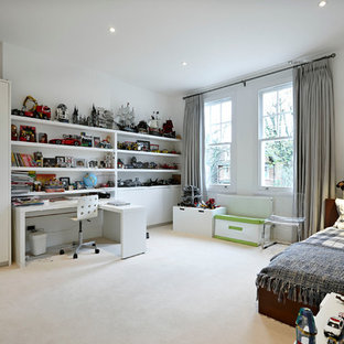 This is an example of a large contemporary children's room for boys in London with white walls and carpet.