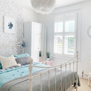 Medium sized classic teen's room for girls in Gloucestershire with white walls, carpet, beige floors and wallpapered walls.