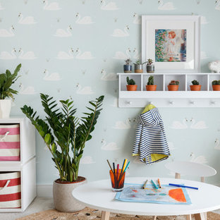 Inspiration for a contemporary gender neutral kids' bedroom in London with multi-coloured walls, carpet and grey floors.