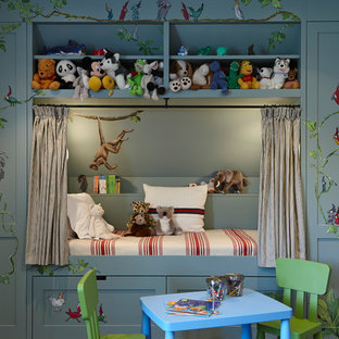 This is an example of a classic gender neutral children's room in London with grey walls.