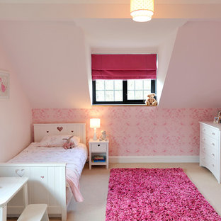 Elegant girl carpeted kids' room photo in London with pink walls