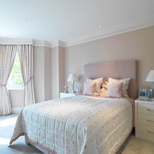 Photo of a medium sized traditional teen's room for girls in London with beige walls and carpet.