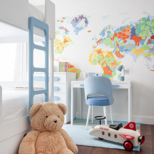 Contemporary children's room for boys in London with multi-coloured walls, dark hardwood flooring and brown floors.
